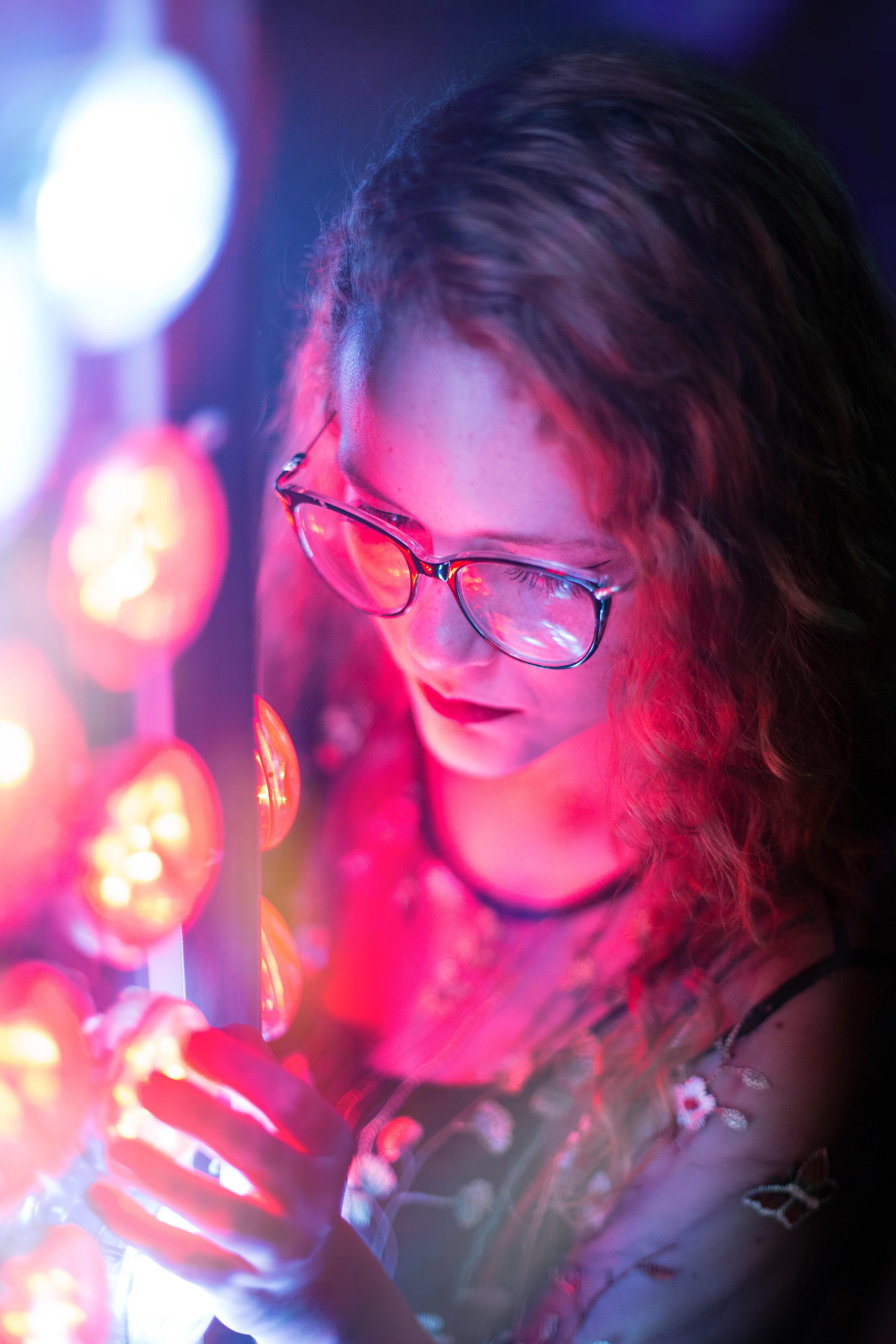 Neon Light Portrait On Behance: Woman In Black Sleeveless Top Wearing Black Framed