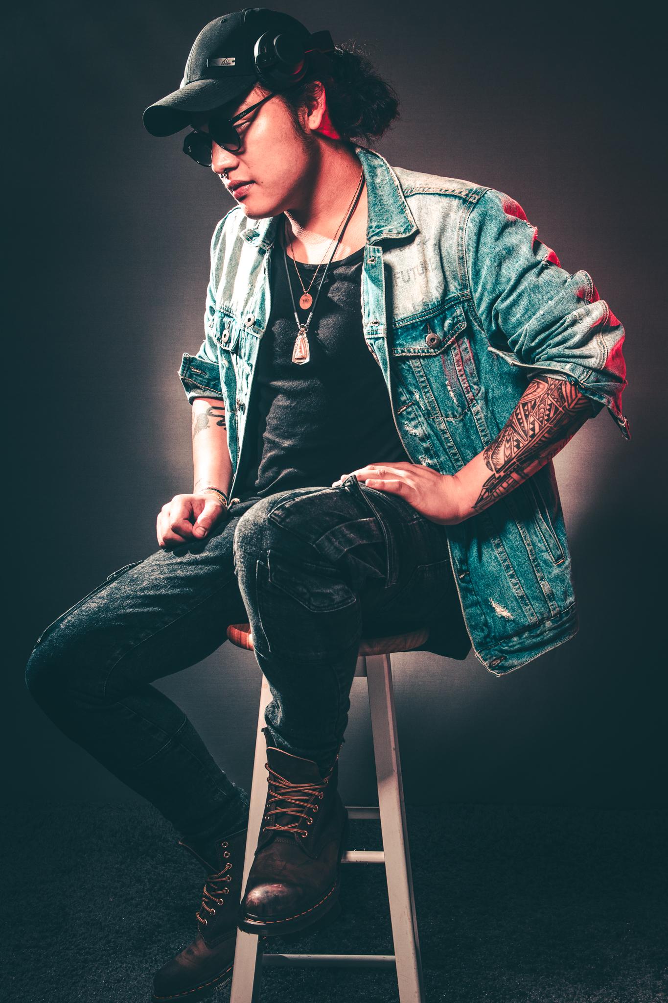 Man Wearing Denim Jacket While Sitting on Chair · Free ... Denim Jacket Photography