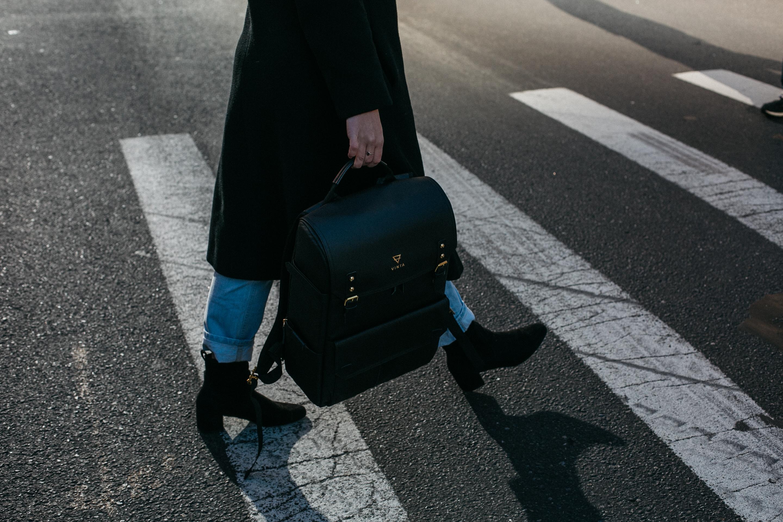 Person Carrying Bag Walking On Pedestrian Lane 183 Free