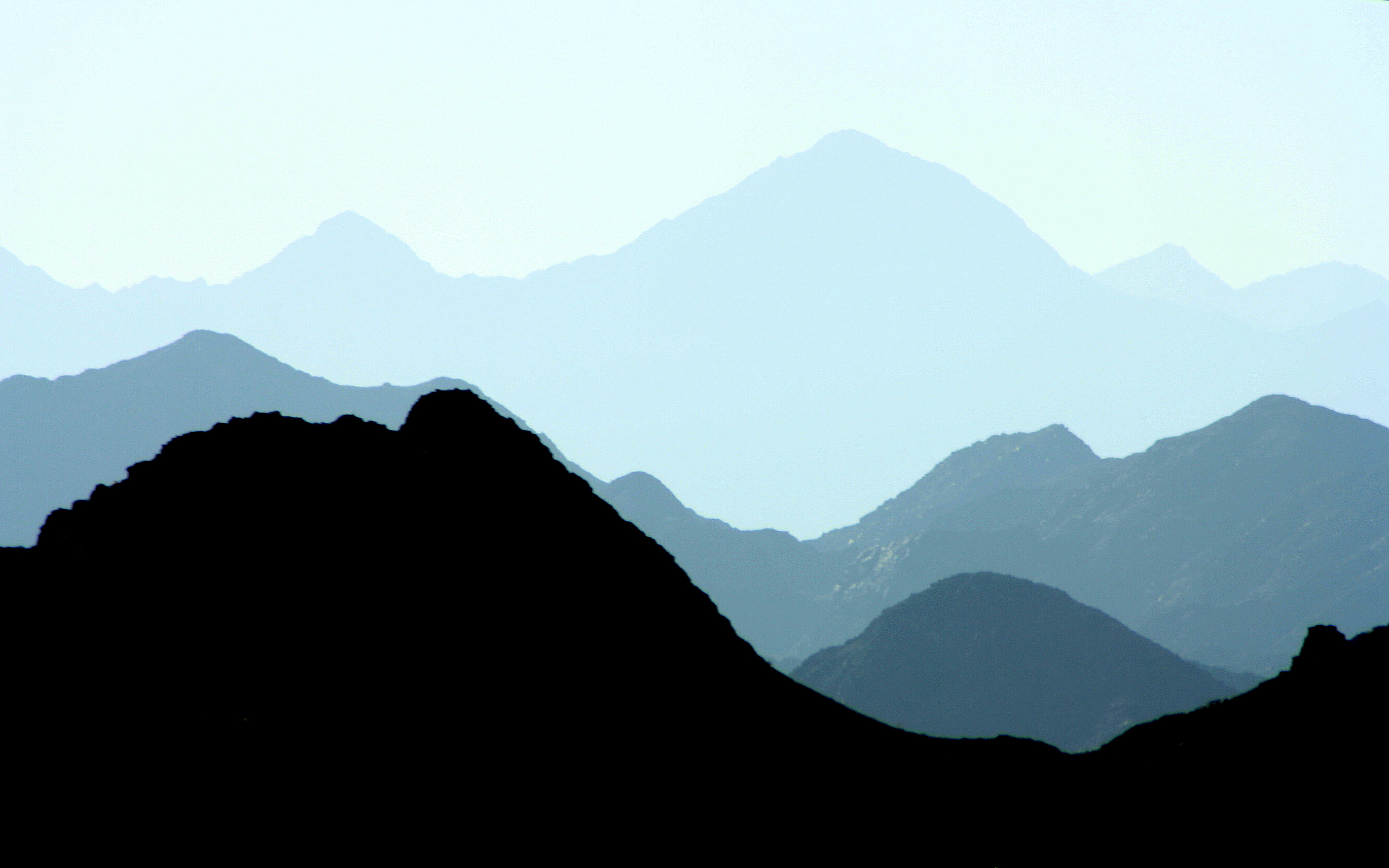 Silhouette of mountains during daytime free stock photo Mountain silhouette