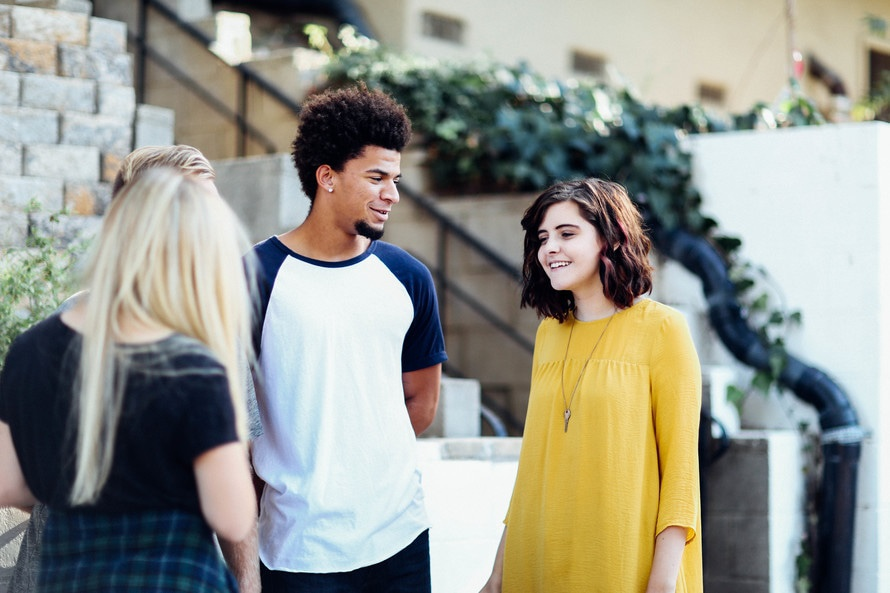 Woman in Yellow Long Sleeved Dress Standing Beside Man in White Blue Crew Neck T Shirt