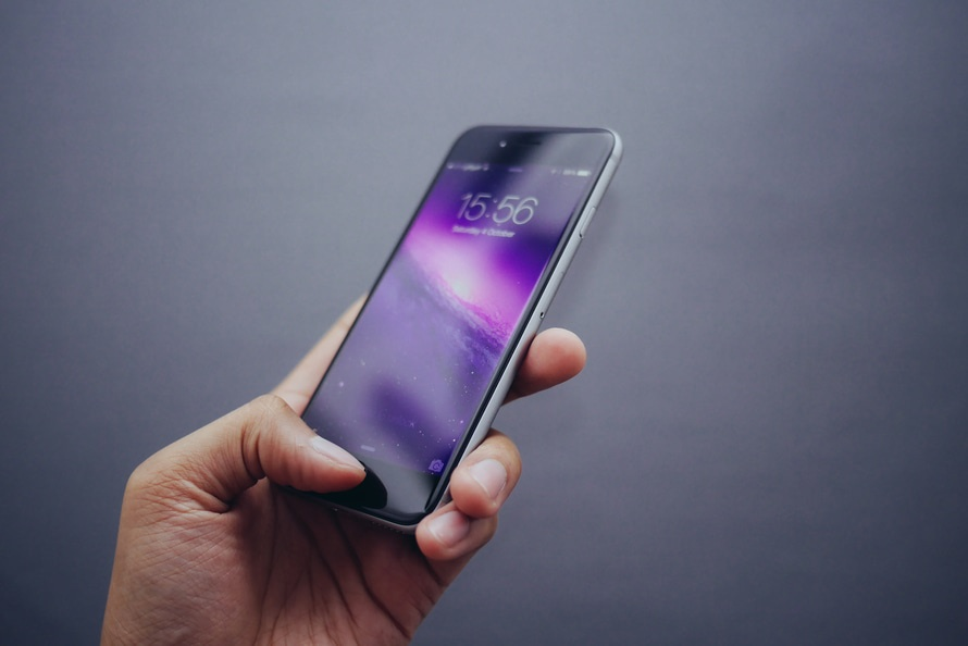 Image of an iPhone holding in one hand