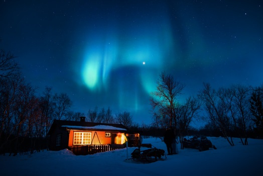 Brown Cottage Under Aurora
