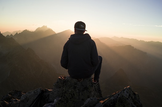 Man Sitting on the Mountain Edge