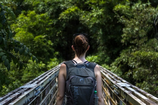 Woman in Black Tank Top and Black Backpack
