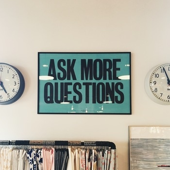 Ask More Questions Signage