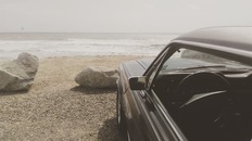 Black Car Parked on the Seashore