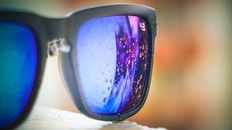 Bubbles Reflected on Lens of Black Framed Sunglasses