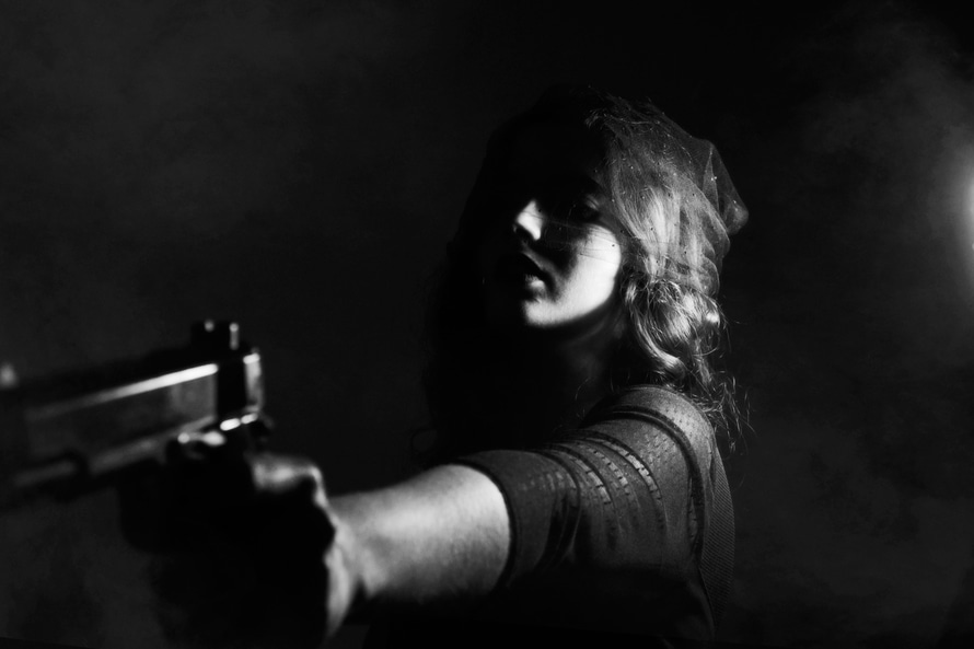Grayscale Photography of Woman Wearing 3 Fourth Sleeve Shirt While Holding a Pistol