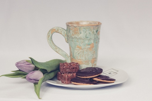 Cookies Flowers and Mug on Plate