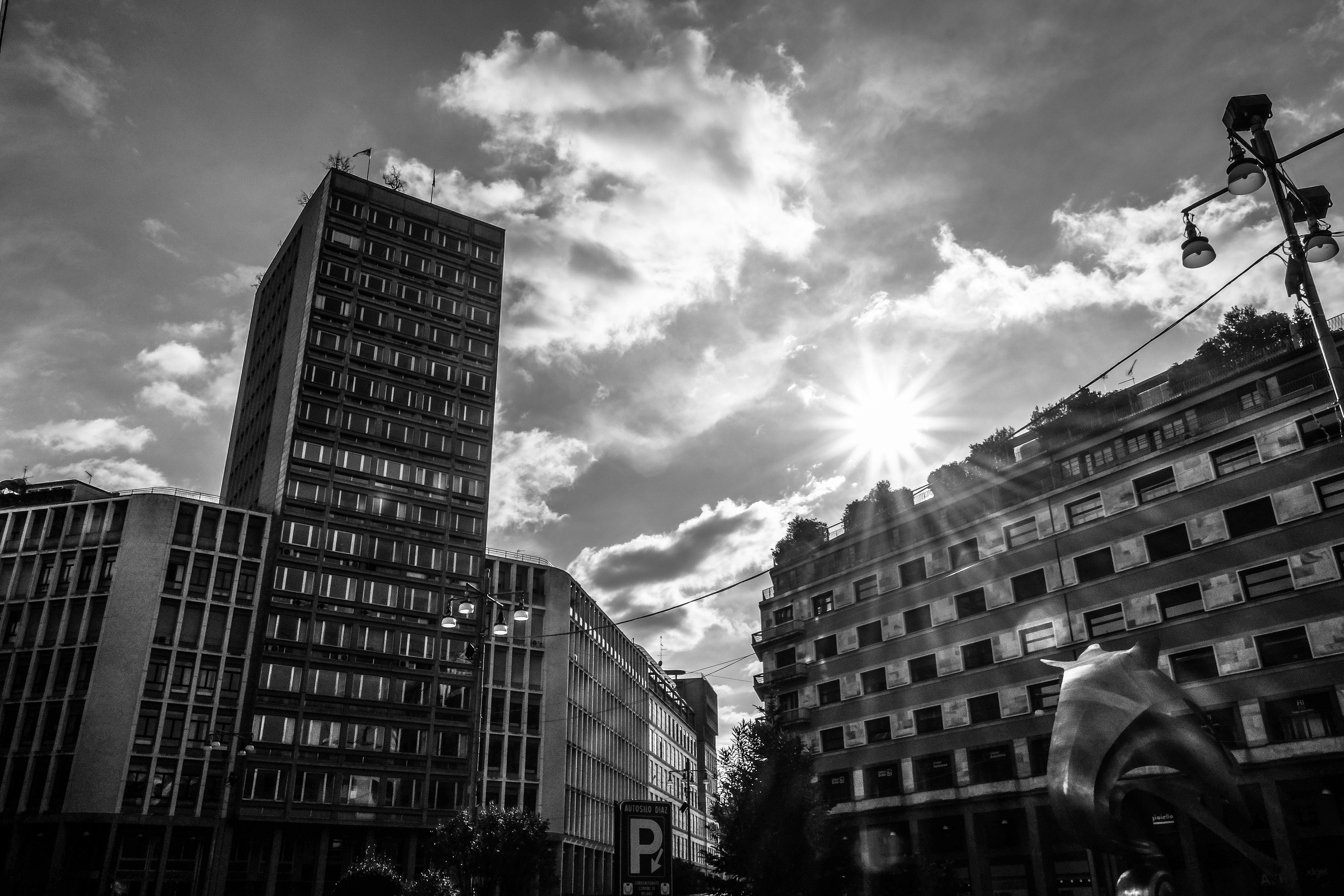 pexels sun grayscale building buildings rise clouds than want piercing through