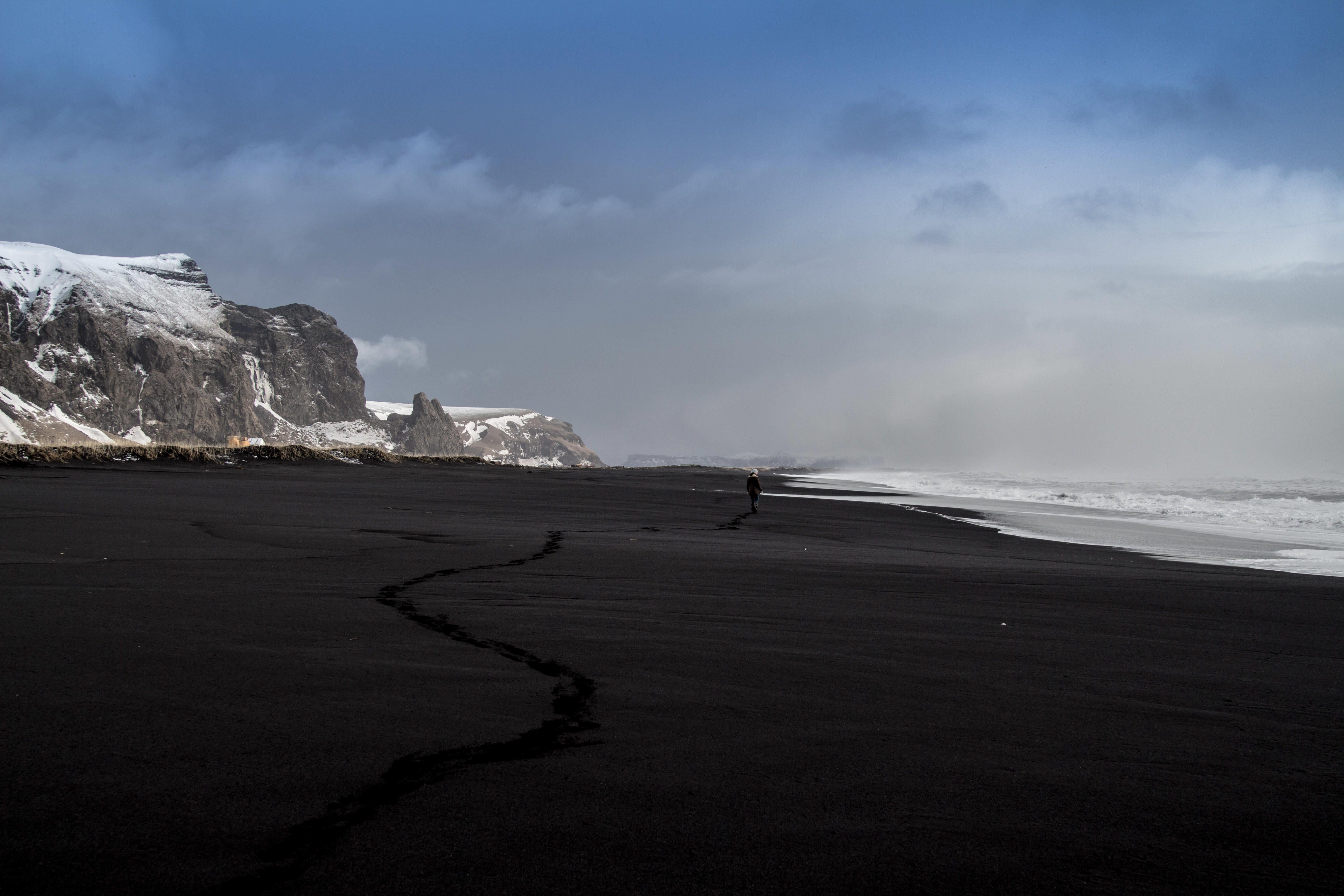Black Sand Seashore Beside Snow Covered Mountain Free